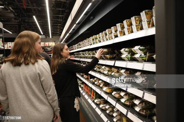 People shop at the newly opened Amazon Go Store on May 07 2019 in New York City The cashierless store the first of this type of store called Amazon...