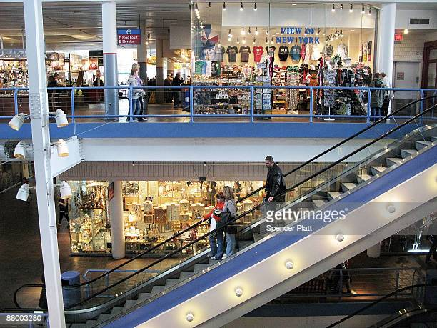 People shop at the Pier 17 mall at South Street Seaport on April 16, 2009 in New York City. The owner of the mall, General Growth Properties Inc....