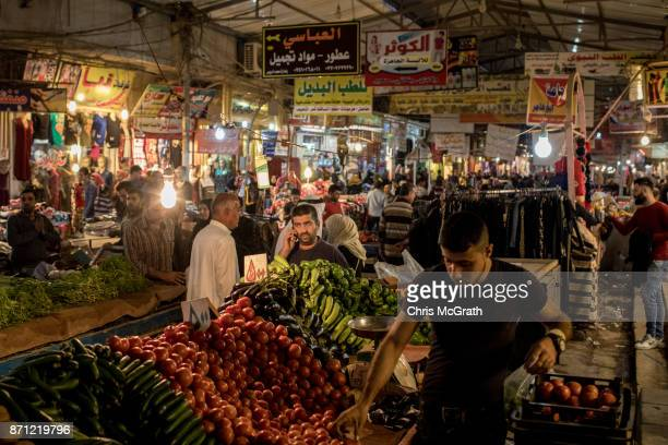 People shop at the Prophet Younis market in East Mosul on November 5 2017 in Mosul Iraq Five months after Mosul Iraq's secondlargest city was...