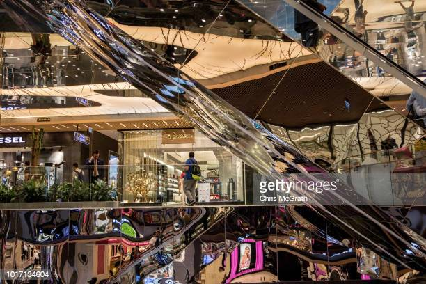 People shop at the Zorlu luxury shopping mall on August 15 2018 in Istanbul Turkey The Turkish Lira recovered to trade at 61 USD despite President...