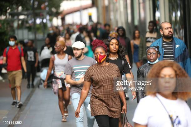 People shop at Westfield shopping centre in east London on June 20 2020 on the first Saturday since nonessential retail stores were able to reopen...