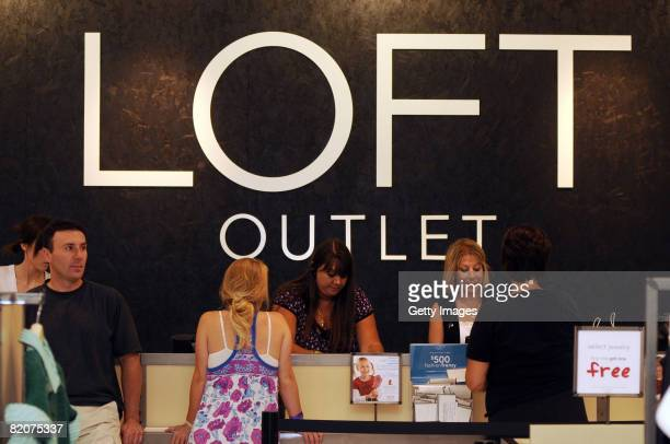 People shop during an Ann Taylor LOFT grand opening at the Chelsea Wrentham Outlet July 26 2008 in Wrentham Massachusetts