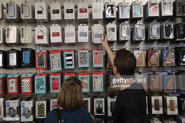 People shop for assessories at Apple's Fifth Avenue store on Earth Day in Midtown Manhattan on April 22 2014 in New York City The store is one of at...
