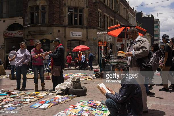 People shop for books in Bogota Colombia on Wednesday March 16 2016 Colombia's central bank raised its benchmark interest rate for a seventh straight...
