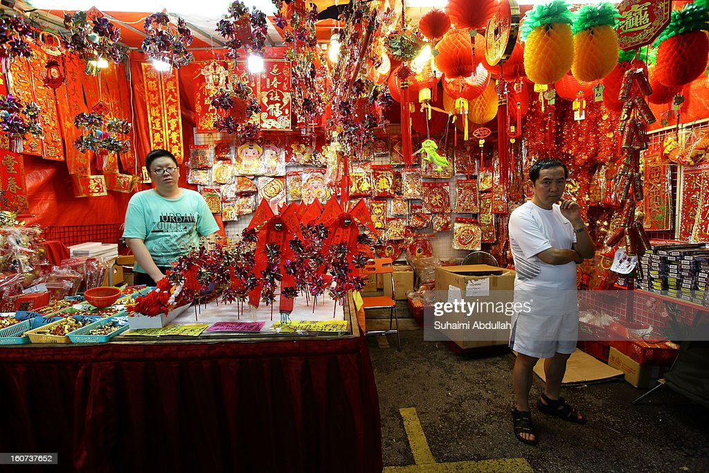 People shop for Chinese New Year decorations in Chinatown on February 4, 2013 in Singapore. On February 10th, Chinese around the world will welcome the Year of the Snake, one of the most anticipated holidays of the Chinese calendar. Also known as the Spring festival or the Lunar New Year, the celebrations last for about 15 days.