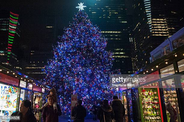People shop for Christmas gifts in Bryant Park on December 24 2016 in New York City Lastminute shoppers hit the stores the day before Christmas