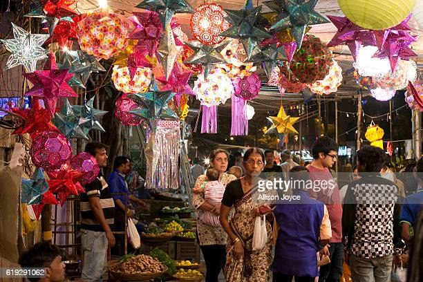 People shop for decorations as Indians celebrate the annual festival of Diwali on October 30 2016 in Mumbai India Diwali the festival of lights is...