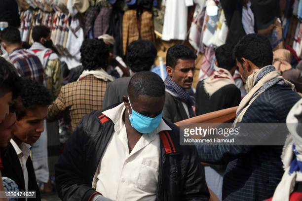 People shop for Eid alFitr amid fears of the spread of the COVID19 on May 22 2020 in Sana'a Yemen The Yemeni authorities have confirmed a large...