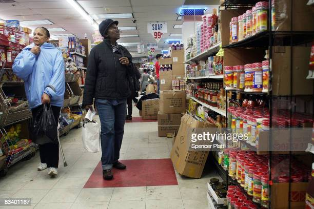 People shop for food at a 99 cent store October 23 2008 in Brooklyn New York A new government report by the Labor Department showed that the number...