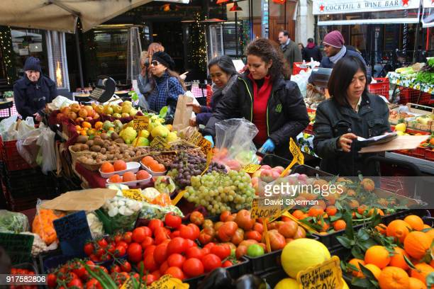 People shop for fresh produce at the iconic Campo di Fiori market where in recent years Bangladeshi migrants have taken over most of the menial labor...