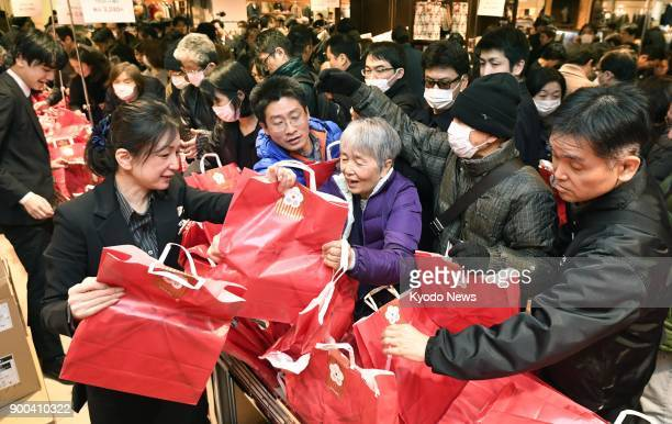 """People shop for """"fukubukuro"""" lucky bags filled with discount goods at a Mitsukoshi department store in Tokyo's Nihombashi district on Jan. 2, 2018...."""