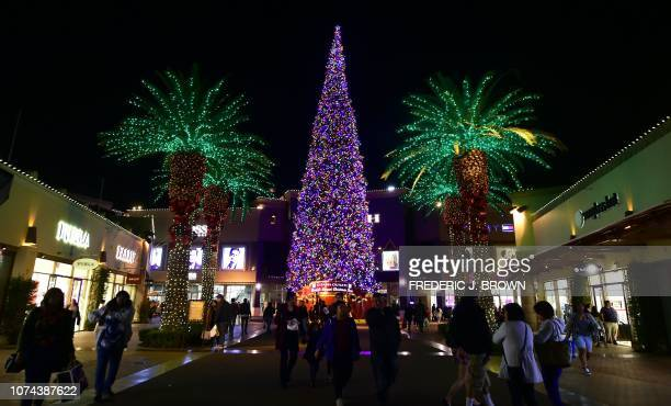 People shop for gifts a week before Christmas on December 18 2018 at an outlet mall in Commerce California billing itself as having the world's...