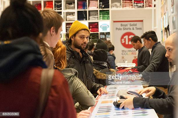 People shop for gifts along Fifth Ave on December 24 2016 in New York City Lastminute shoppers hit the stores the day before Christmas