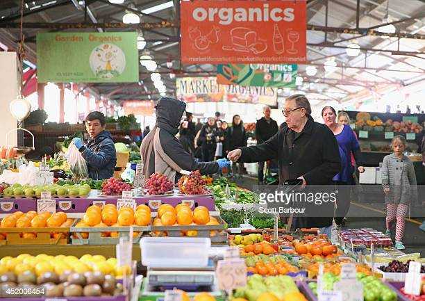 People shop for organic fruit and vegetables at the Queen Victoria Market on July 11 2014 in Melbourne Australia The 135yearold Queen Victoria Market...