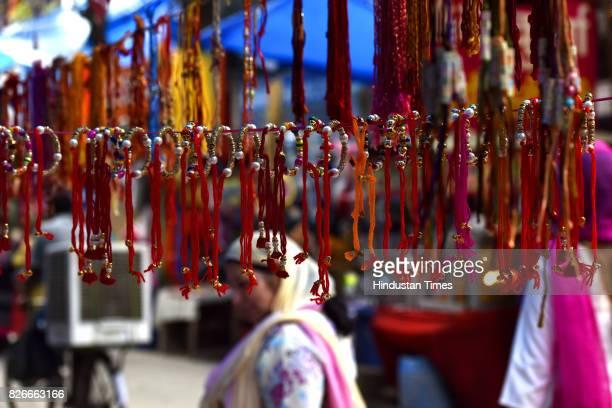 People shop for rakhi ahead of Raksha Bandhan at Indira Market on August 4 2017 in Noida India Raksha Bandhan or simply Rakhi is a Hindu festival...