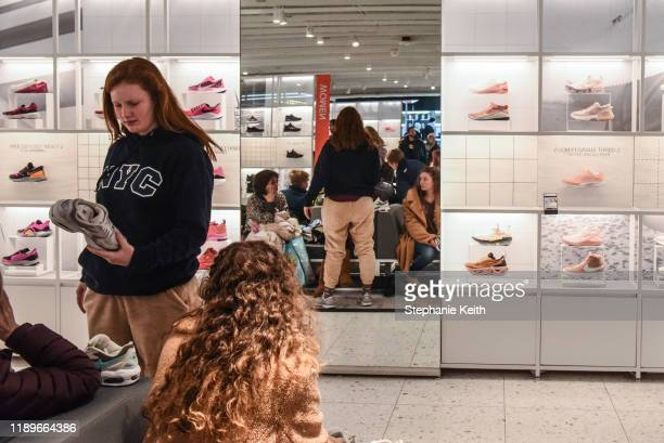 People shop for sneakers at the Nike flagship store on 5th Ave. On December 20, 2019 in New York City. Revenue in the North American market, which...