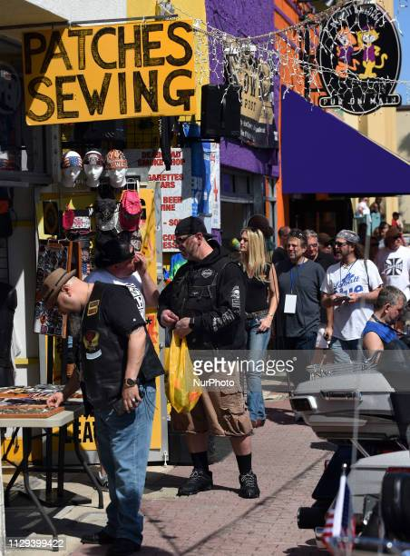 People shop for souvenirs on Main Street on March 8 the opening day of Bike Week in Daytona Beach Florida The 10day event which draws thousands of...