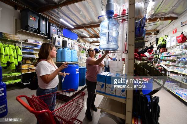 People shop for supplies including food and water at SOS Survival Products in Van Nuys California on July 8 a few days after southern California was...