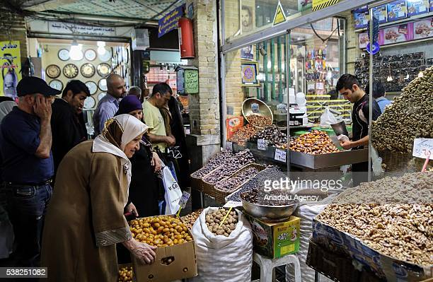 People shop for the Ramadan month at the Tajrish Bazaar in Tehran Iran on June 5 2016 Ramadan is observed by Muslims worldwide as a month of fasting...