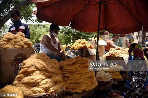 People shop for vermicelli ahead of Eid-ul-Fitr, in Sadar Bazar, near Sohna Chowk, on May 23, 2020 in Gurugram, India.