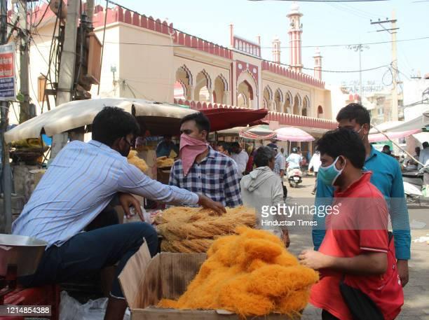 People shop for vermicelli ahead of Eid-ul-Fitr, in Sadar Bazar, on May 24, 2020 in Gurugram, India.