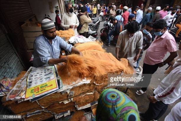 People shop for vermicelli on the eve Eid-ul-Fitr, at Jama Masjid, on May 24, 2020 in New Delhi, India.