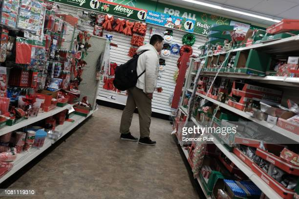 People shop in a dollar store on December 11 2018 in the Brooklyn borough of New York City As the income gap between rich and poor continues to grow...
