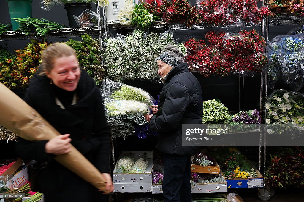 People shop in a flower store in the floral district on February 13, 2013 in New York City. With Valentines Day tomorrow, the district is experiencing a rush of floral buyers and sellers to service customers on the national day of romance. Along with Mother's Day, Valentine's Day is one of the busiest days of the year for florists and flower growers.