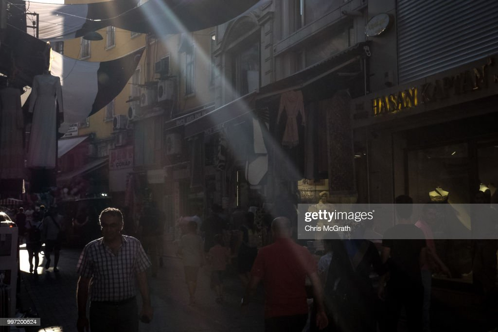 People shop in a market street on July 12, 2018 in Istanbul Turkey. Following Turkey's President Recep Tayyip Erdogan's re-election victory and the appointment of his son-in-law Berat Albayrak to lead the Treasury and Finance Ministry fears are growing that Turkey's economy is heading into crisis . The Turkish Lira, has plunged by approximately one-fifth this year raising prices for businesses and households.