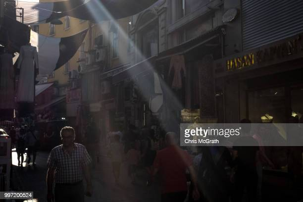 People shop in a market street on July 12 2018 in Istanbul Turkey Following Turkey's President Recep Tayyip Erdogan's reelection victory and the...