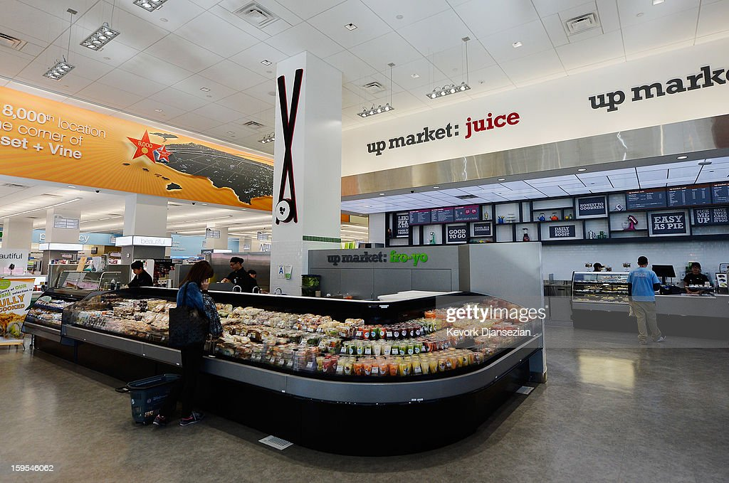 People shop in a new Walgreens at the corner of Sunset and Vine on January 15, 2013 in Hollywood, California. The new 23,500-square-foot, drugstore, the company's 8,000th store and first West Coast flagship, includes high-end cosmetic, skinand hair care brands, a frozen yogurt station, a fresh sushi bar, a coffee and espresso bar, a juice and smoothie bar, a wine and spirits shop with a and a virtual bartender kiosk and a cigar humidor.