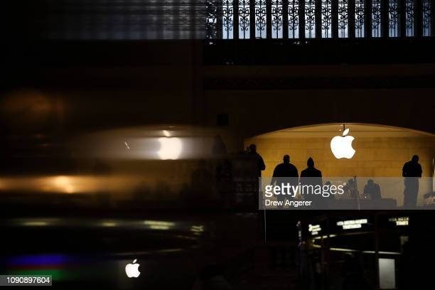 People shop in an Apple retail store in Grand Central Terminal January 29 2019 in New York City Apple is set to report firstquarter earnings results...