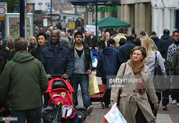 People shop in Kingston Upon Thames town centre on April 19th, 2008 in London, England. Tomorrow is the anniversary of right-wing politician Enoch...