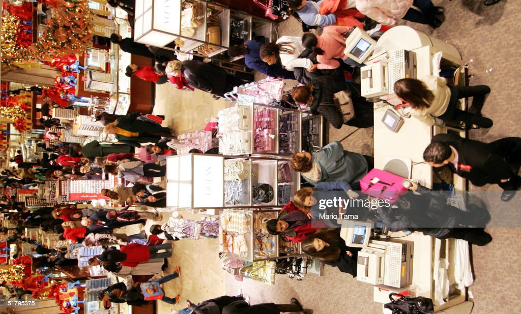 People shop in Macy's department store November 26, 2004 in New York City. The Friday after Thanksgiving, called 'Black Friday,' is one of the busiest shopping days of the year with stores opening early and a large number of shoppers looking for holiday gifts.
