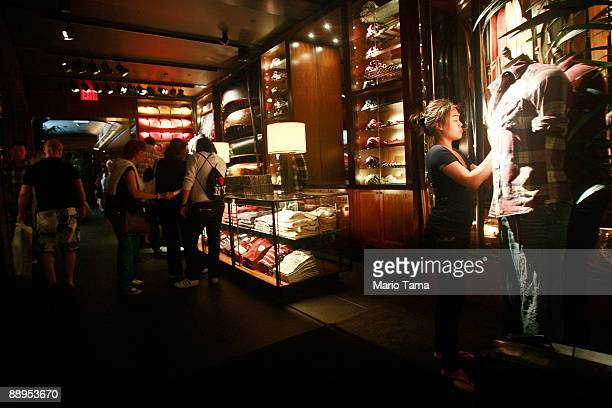 People shop in the Abercrombie Fitch flagship store July 9 2009 in New York City Abercrombie Fitch Co posted a 32 percent drop in samesale stores in...