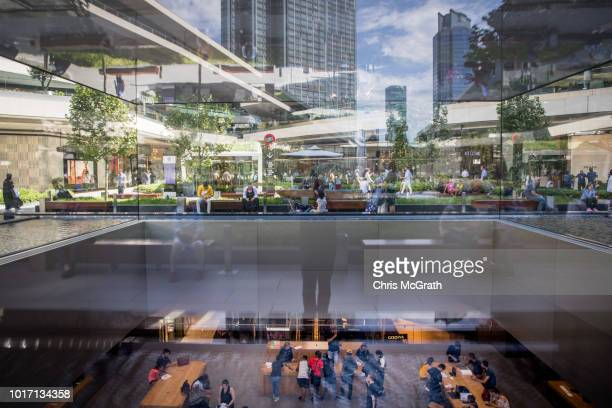 People shop in the Apple Store in the Zorlu luxury shopping mall on August 15 2018 in Istanbul Turkey The Turkish Lira recovered to trade at 61 USD...