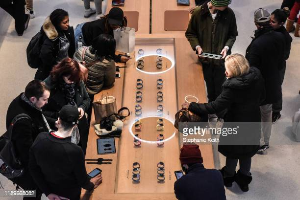 People shop in the Apple store on 5th Ave. On December 20, 2019 in New York City. Despite a healthy consumer economy the U.S. Saw more than 9,000...