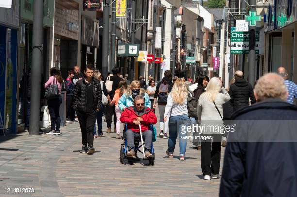 People shop in the high street as nonessential retail shops are open on May 19 2020 in Douglas Isle of Man The Isle of Man began lifting COVID19...