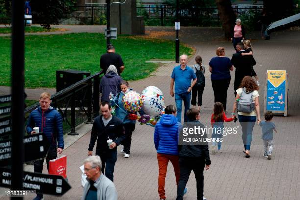 People shop in The Maltings shopping centre in Salisbury southern England on September 4 2020 which was the scene of the nerve agent attack on...