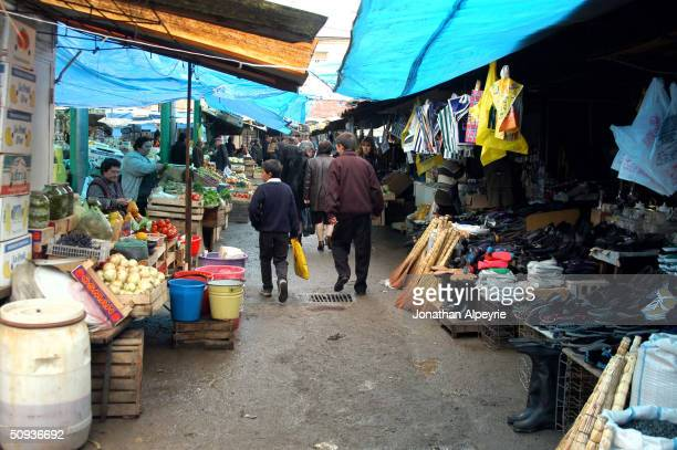 People shop in the market in the town of Stepanakert May 16, 2004 in the Askeran Province of Nagorno-Karabakh, Azerbaijan. The market sells...