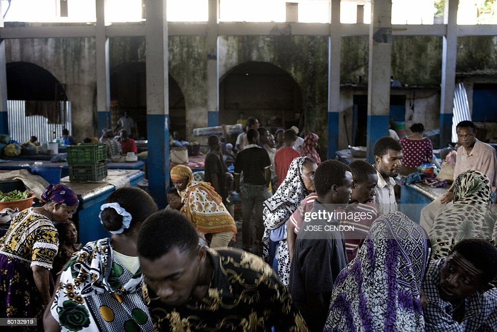 People shop in the market of Moroni, the : News Photo