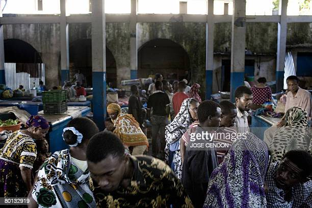 People shop in the market of Moroni the capital of the Union of Comoros on March 5 2008 The renegade Comoros island of Anjouan is heading for armed...