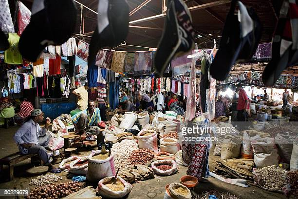 People shop in the market of Mutsamudu the capital of Anjouan on March 13 2008 As the African Union prepares to invade the rebel Indian Ocean island...