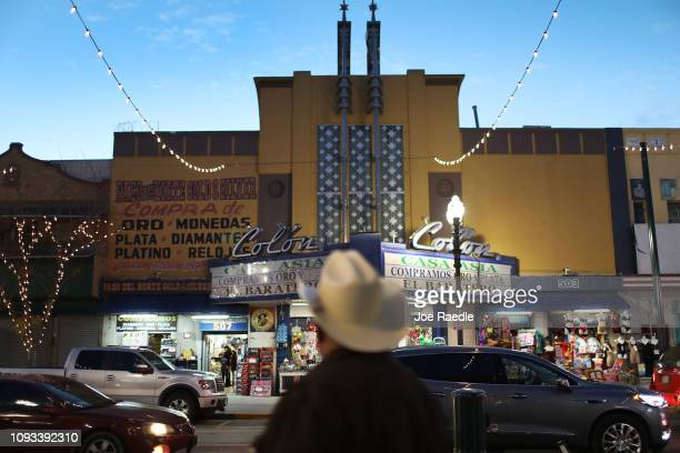 People shop in the stores near the border crossing with Mexico as the United States government continues its shutdown over a fight to fund more...