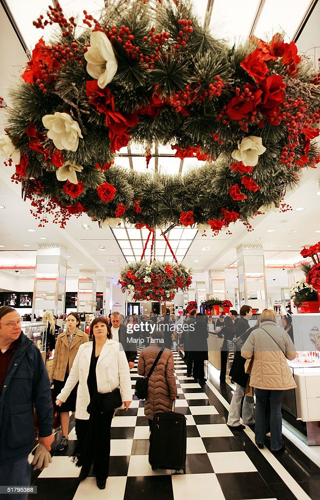 People shop inside Bloomingdale's department store November 26, 2004 in New York City. The Friday after Thanksgiving, called 'Black Friday,' is one of the busiest shopping days of the year with stores opening early and a large number of shoppers looking for holiday gifts.