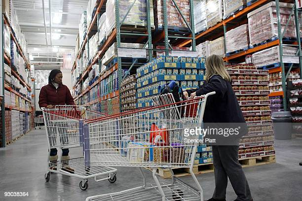 People shop inside of a recently opened Costco warehouse store on November 13 2009 in New York City The store the first in Manhattan opened in a...