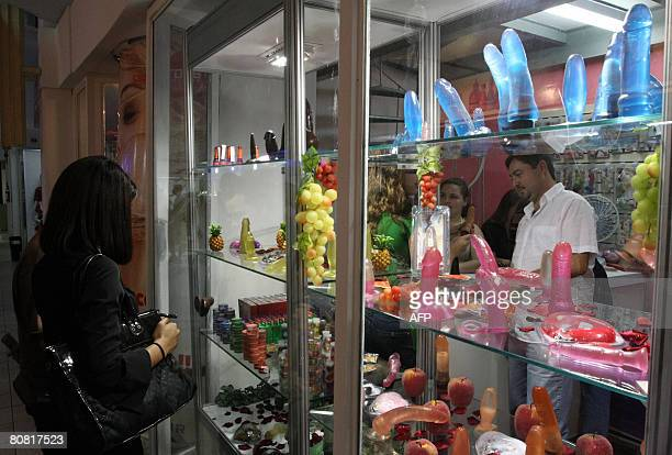 People shop on April 19 2008 at the 12th Erotika Fair Latin America's biggest erotica trade show held at the exhibition hall Mart Centre in Sao Paulo...