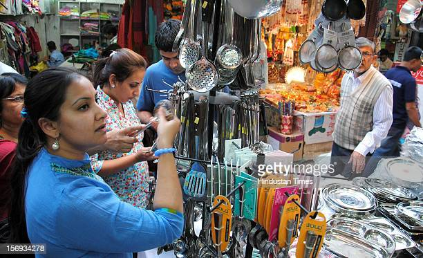 People shop on the eve of Diwali festival at Sector 27 market, on November 11, 2012 in Noida, India.