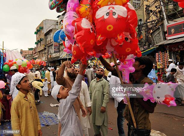 People shop outside the Jama Masjid after offering prayers on the occasion of EidalFitr at Jama Masjid Mosque on August 9 2013 in New Delhi India...