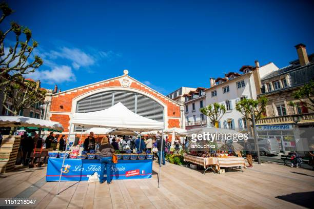 people shopping around biarritz market hall, france - biarritz stock pictures, royalty-free photos & images